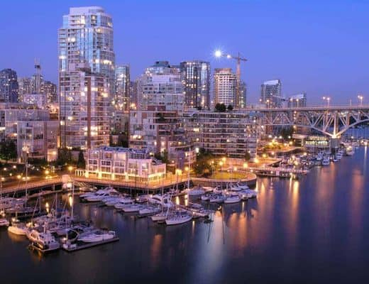 Nighttime Vancouver city and water scene.