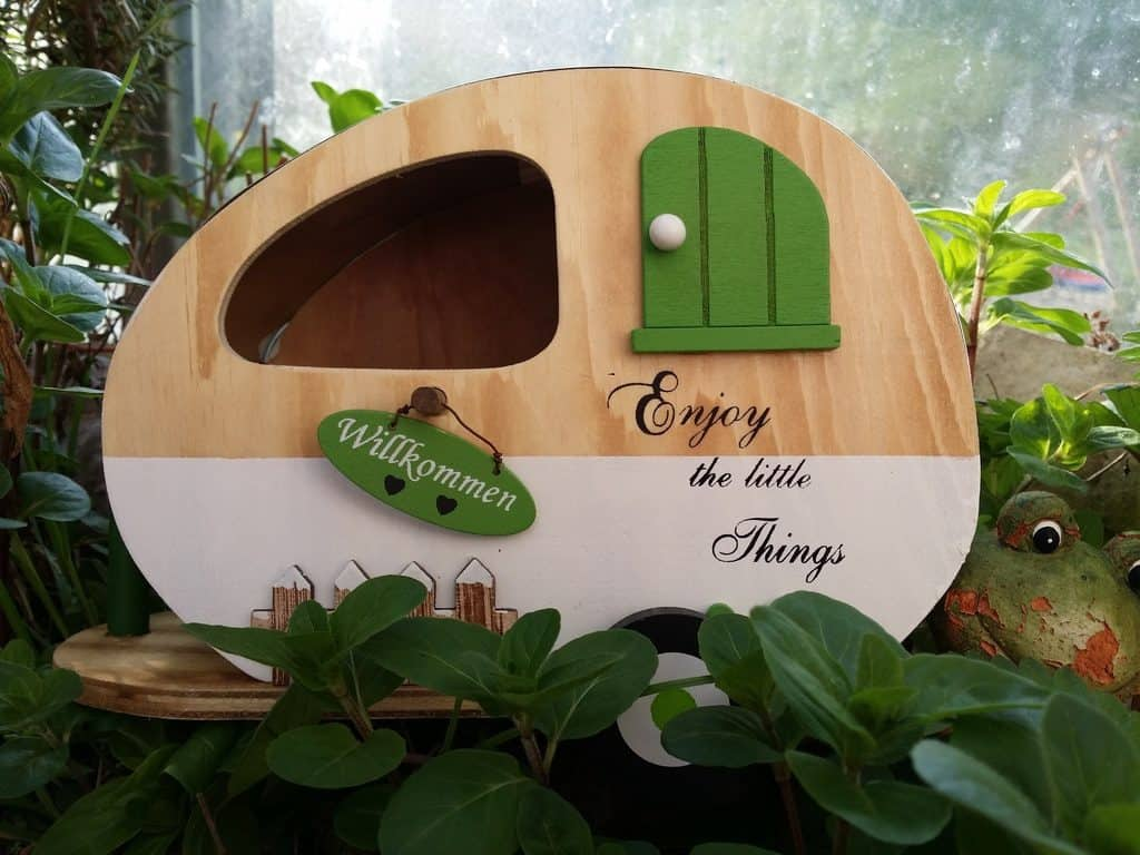 Wooden model retro camping trailer.